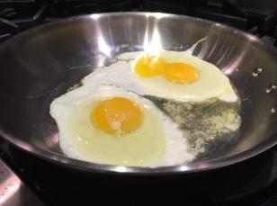 fried eggs in pan